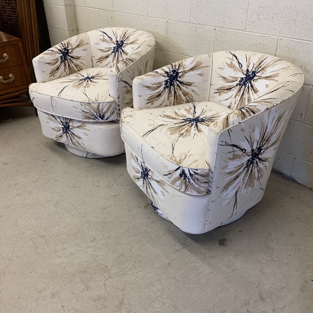 Gorgeous pair of swivel club chairs in pristine condition. Not sure if fabric is a reupholstery or not, but it's perfect....