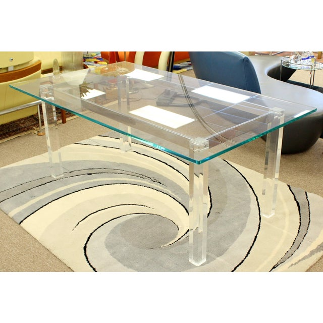 For your consideration is a fabulous, dining table, with a glass top, chrome base and Lucite legs, by Charles Hollis...