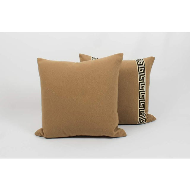Pair of custom camel color wool blend pillows with coordinating black-and-ivory colored Greek key tape on fronts. Solid...