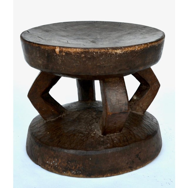 Beautifully carved from a single piece of wood, aged and used stool by the Dogon people of Mali. This stool has developed...