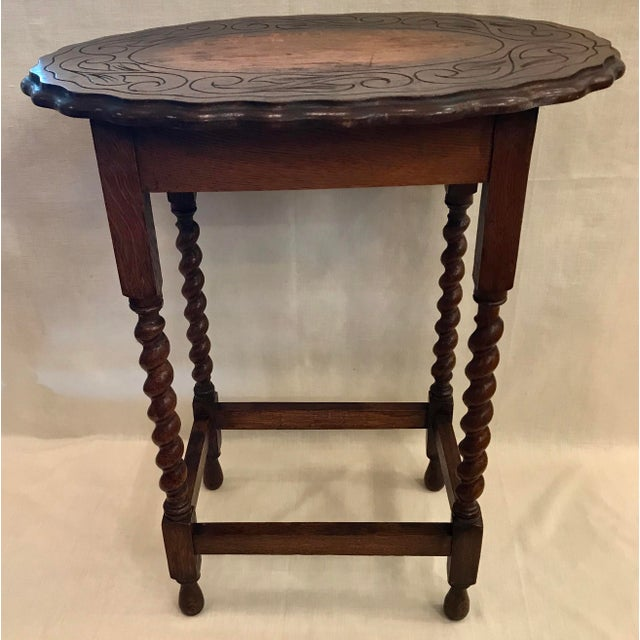 This is a beautiful barley twist lamp/occasional table. The piece features an oval pie crust or scalloped edge top and a...