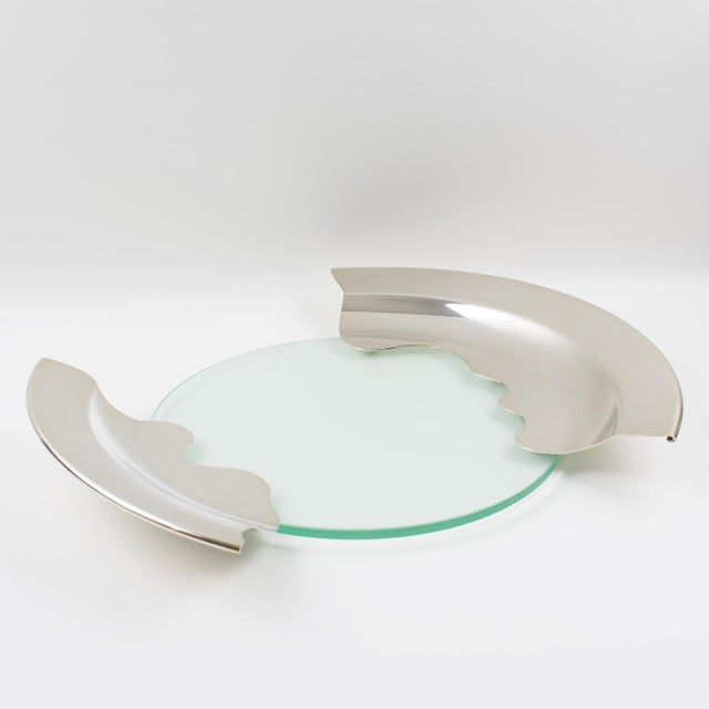 A wonderful modernist 1980s polished silver plate platter bowl or centerpiece. Interesting futurist design with round...