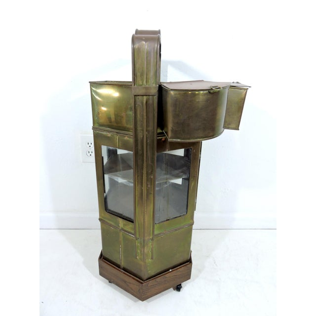Old solid brass Asian street vendors food box complete with detachable condiment containers and a variety of other brass...