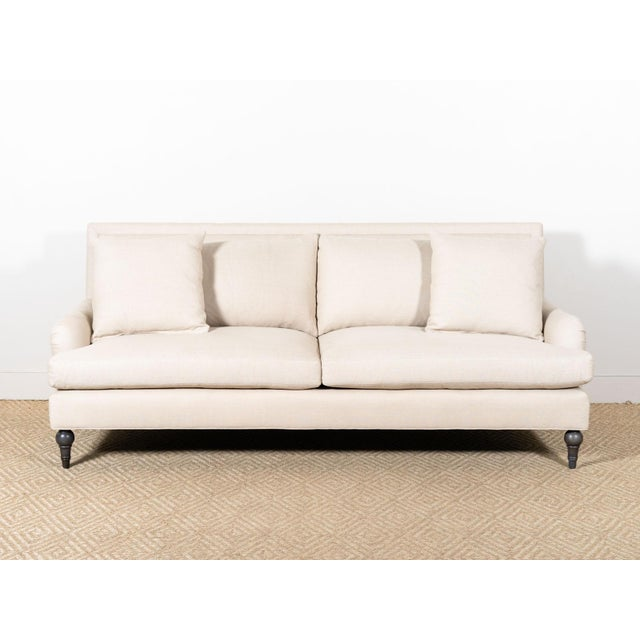 Upholstered sofa with a serpentine base Fabric: Glynn Natural 100% Linen Microdown seat cushions and back pillows Two...
