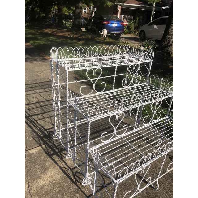 Mid 20 th Century Metal plant stand or display shelves. Three tiered shelf , each shelf 9 inches deep. White in color with...