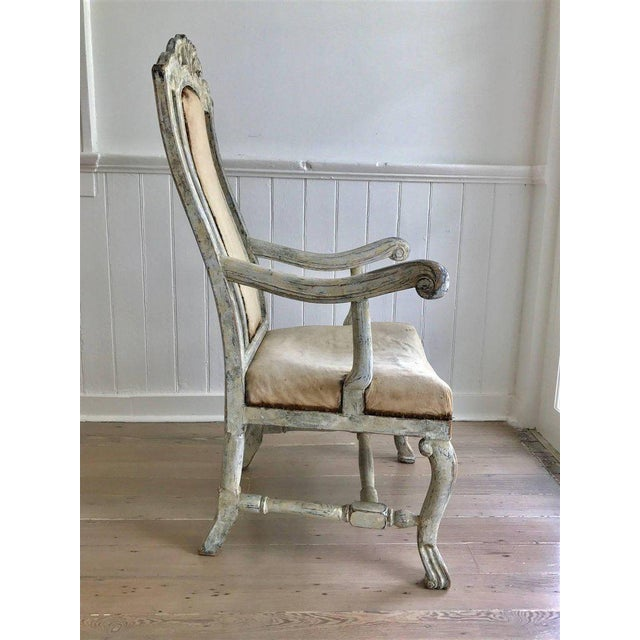 Robustly styled and carved Swedish Baroque armchair with original cream colored paint, now worn to a very attractive...