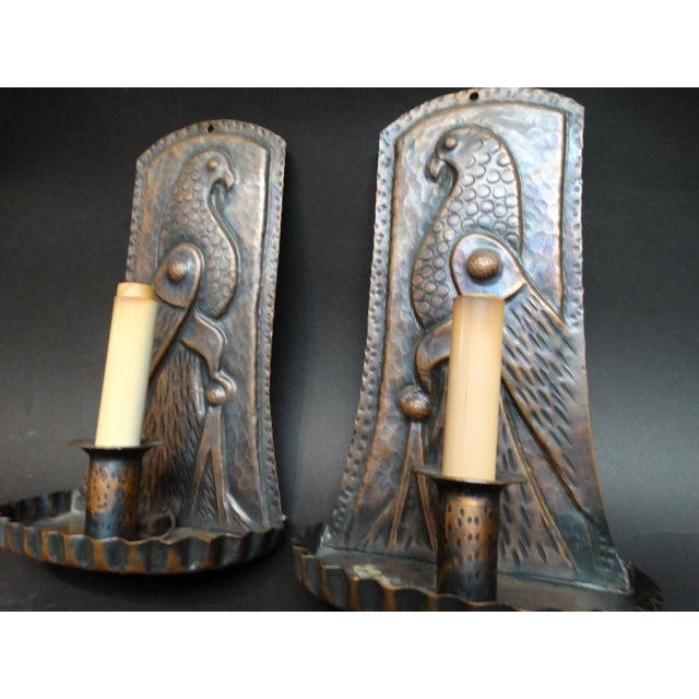 Elegant and beguiling, and Arts & Crafts to the max, this pair of sconces will lend real enchantment to any interior....