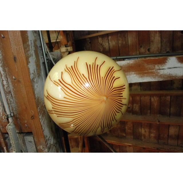 Italian vintage pendant with hand blown cream Murano glass globe and brown Murano glass stripes / Designed by Ludovico...