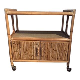 1970s Hollywood Regency Rattan Tiered Bar Cart on Brass Castors For Sale