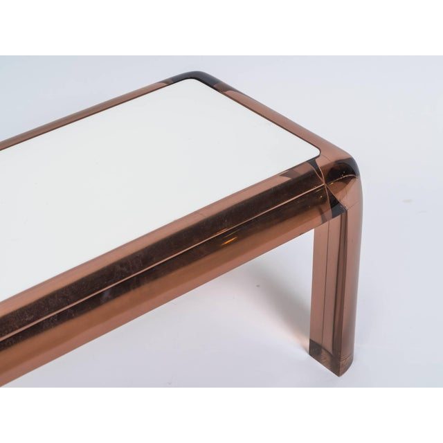 Chunky brown Lucite table with white plastic top. Great to be used as a side table or small cocktail table.