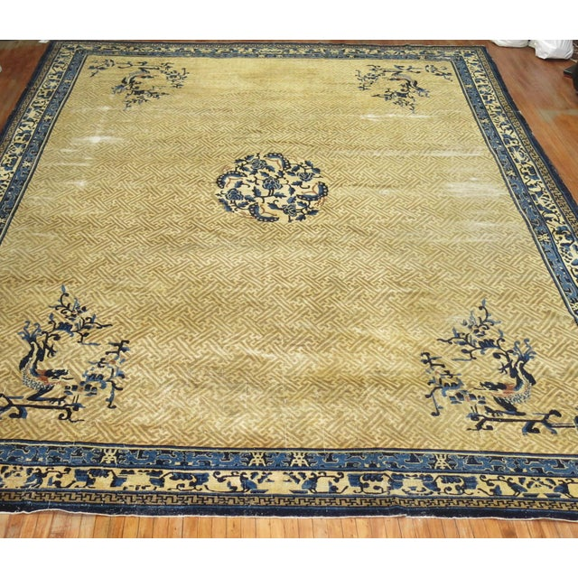 A rare oversize Chinese Peking rug in tans and blue. Peking rugs consist of designs that are simpler and asymmetrical,...
