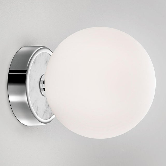 Deluxe bathroom Wall Light. This bathroom light is made in polished chrome and has a frosted globe. The backplate of the...