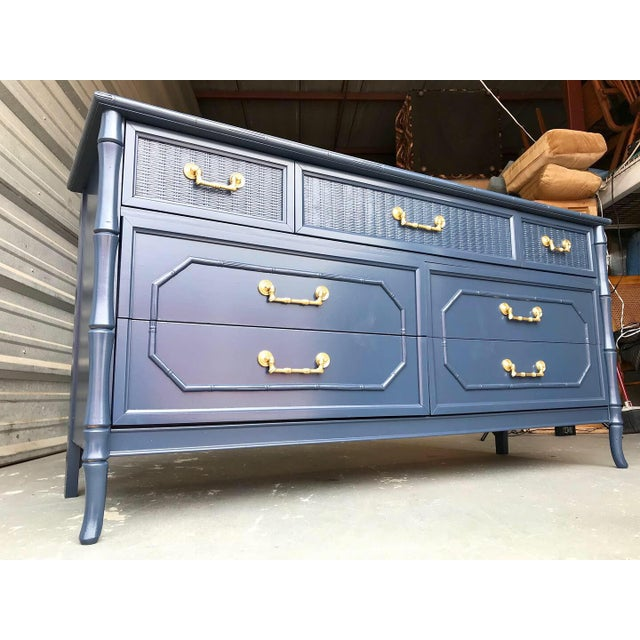 Amazing vintage Hollywood Regency, faux bamboo Broyhill seven-drawer dresser newly lacquered in a navy blue with lovely...