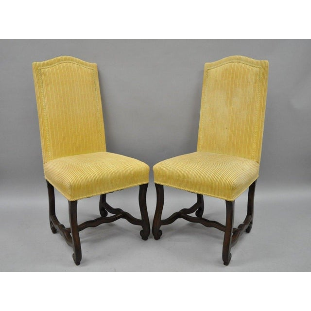 Set of Ten Vintage Walnut Os De Mouton Louis XIV French Style Upholstered Dining Side Chairs. Listing includes 10 armless...