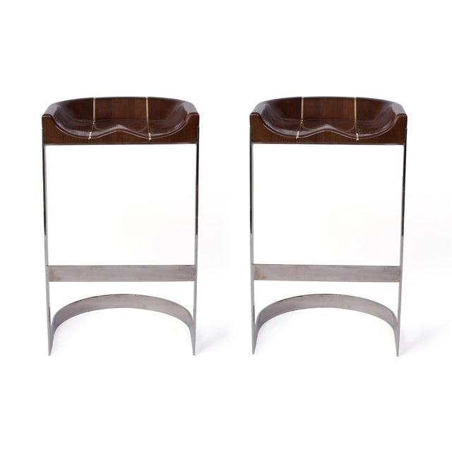 Early 1970s pair of solid oak and chrome barstools by Warren Bacon. Seats feature sleek brass inlay details. Price listed...