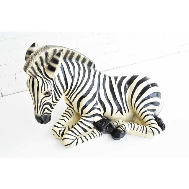 Graceful ceramic zebra, made in Italy. Stamped. Great for a coffee table, large shelf, console or dining centerpiece.