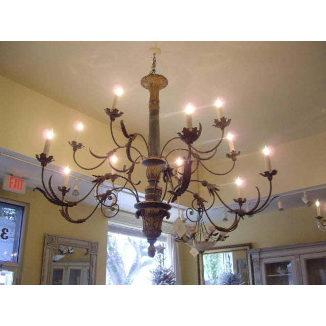 Large very elegant Italian painted giltwood and iron twelve-light chandelier. Circa 1800.