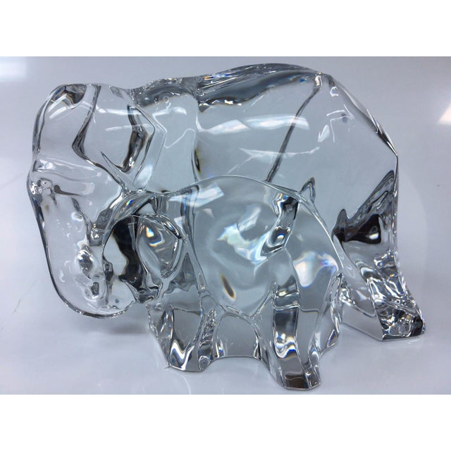 Baccarat crystal elephant with baby. It measures approximately 5.5'' x 9''. This piece is in excellent used condition with...