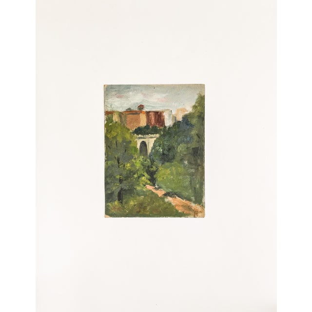 Unframed, 19th century antique oil painting on board of a bridge surrounded by trees with a village in the background.