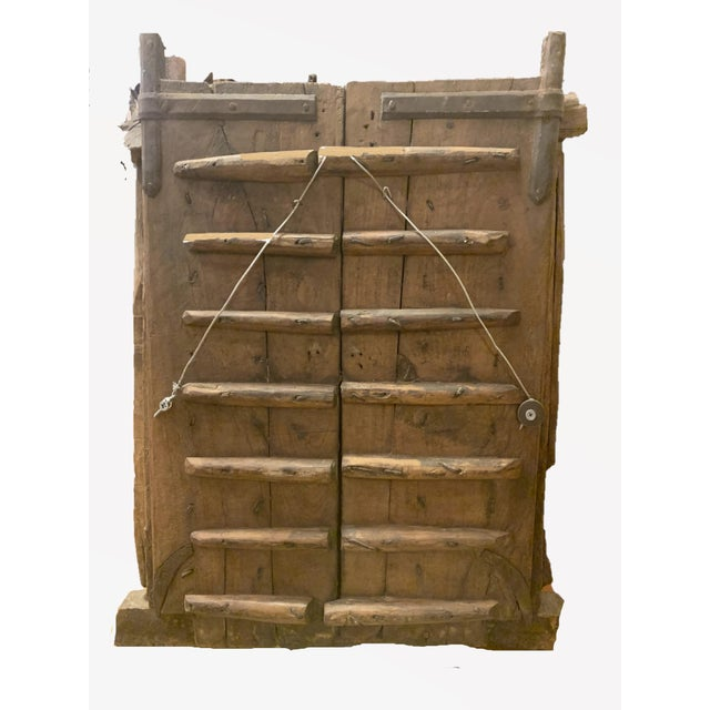 This rustic, early 1900's hand carved antique window with iron bars would make a statement wall decor panel. This Mehrab...
