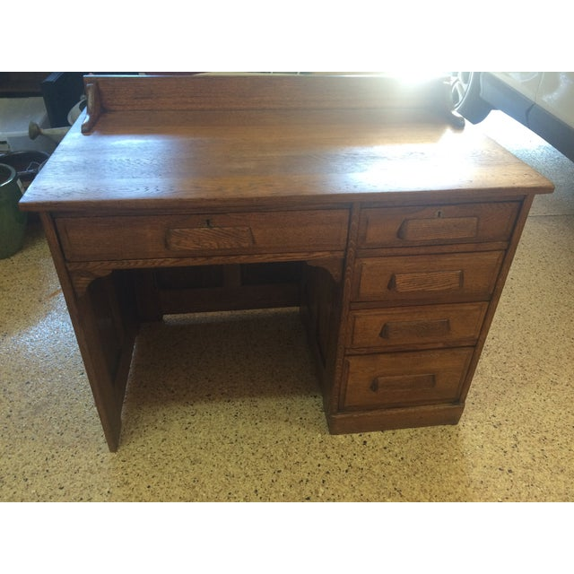 Refinished antique oak teacher's desk. 42