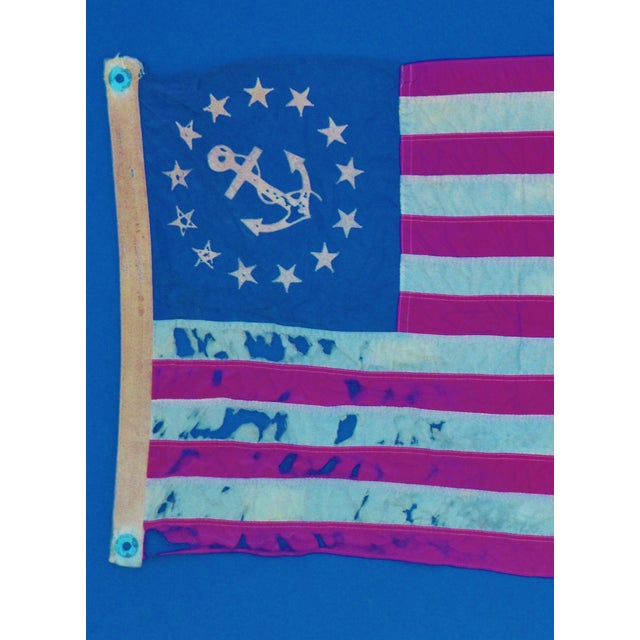 Framed anchor insignia American flag from a Chris-Craft boat, circa 1950. Flag is mounted on a linen fabric matte board...