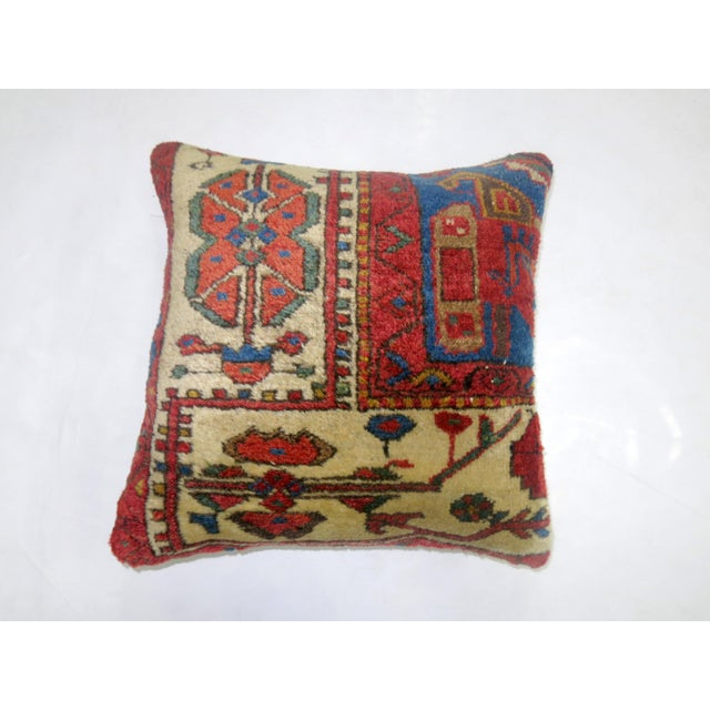 Pillow made from a vintage rug with cotton back. Zipper closure and foam insert provided. 16'' x 17''