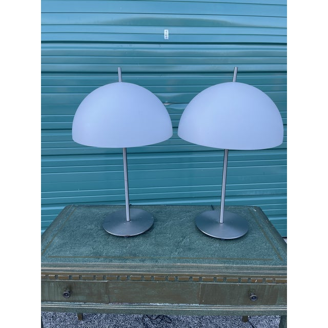 Pair of hard to find Kovacs for Sonneman steel. Acrylic dome lamp shades. Both have dimmer switch roller switches on the...