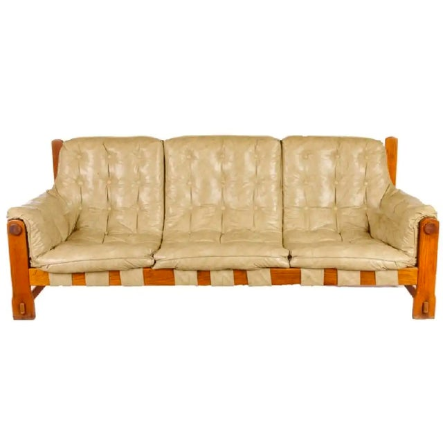 """Tufted soft tan naugahyde upholstery and oak frame sofa, unmarked; measures approximately 30-1/2"""" high by 78-1/7"""" wide,..."""