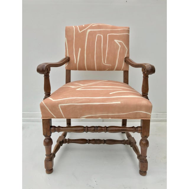 A good looking French renaissance style lolling chair of walnut dressed up well in iconic Graffito linen. The chair sits...