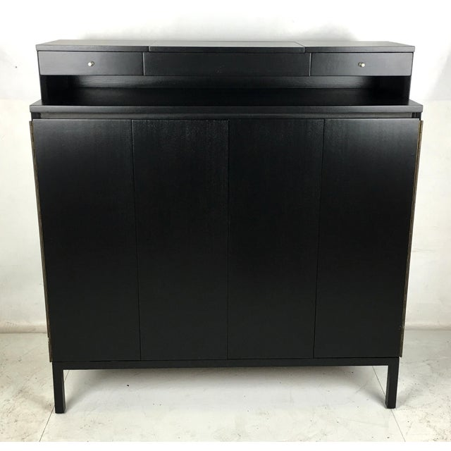 Ebonized wardrobe cabinet by Paul McCobb for Directional- made by Calvin for the Irwin collection. The chest has been...