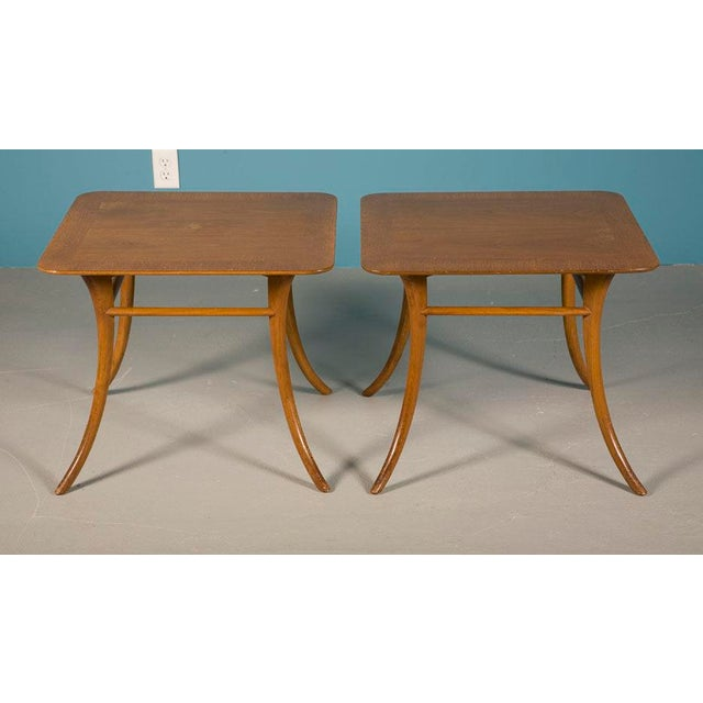 A pair of sabre leg lamp tables, mod. no. 3314, by T.H. Robsjohn-Gibbings for Widdicomb. American, circa 1950.