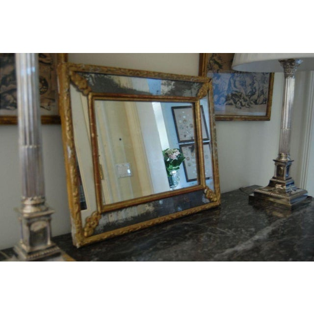 19th century French mirror a par clause with gently worn gold leaf frame and old glass.