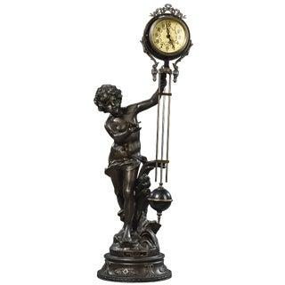 Auguste Moreau Amour Petit Sculpture Swinging Figural Clock For Sale
