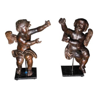 16th Century Italian Carved Cherubs from a Church on Marble Bases - a Pair For Sale