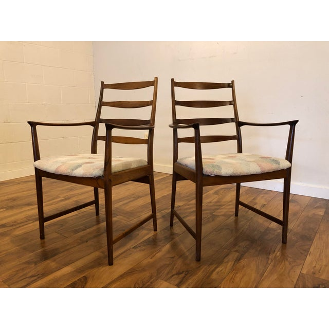 Pair of gorgeous rosewood armchairs by Torbjorn Afdal for Vamo, made in Denmark. These contoured ladder back armchairs...