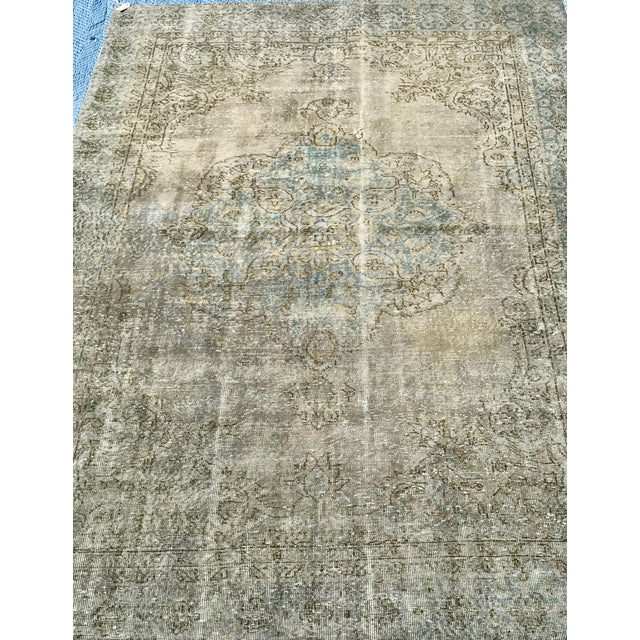 One-of-a-kind, low pile Turkish handmade rug from the 1920's has been shaved down, to bring out it's original beauty and...