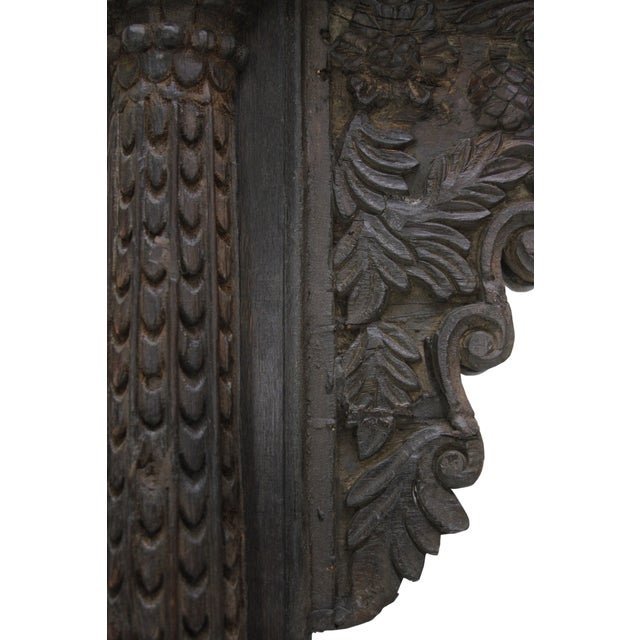 A wonderful, antique Indian balcony piece masterfully repurposed as a unique mirror. It features a fully carved frame with...