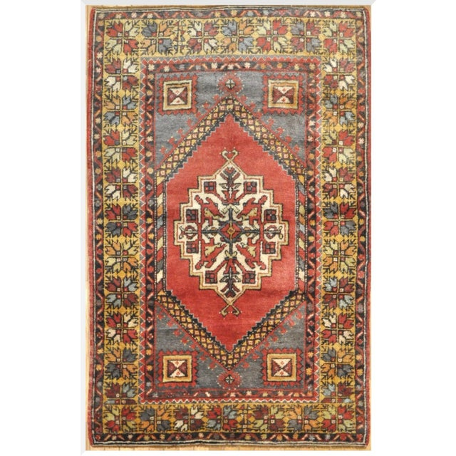 This is a beautiful vintage handmade rug with a simple geometric design from Turkey. The rug measures 3' 6'' x 5' 7'' and...