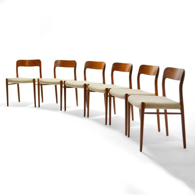 An exceptional set of Niels O. Møller model 75 chairs in rich teak by J.L. Møllers Møbelfabrik.