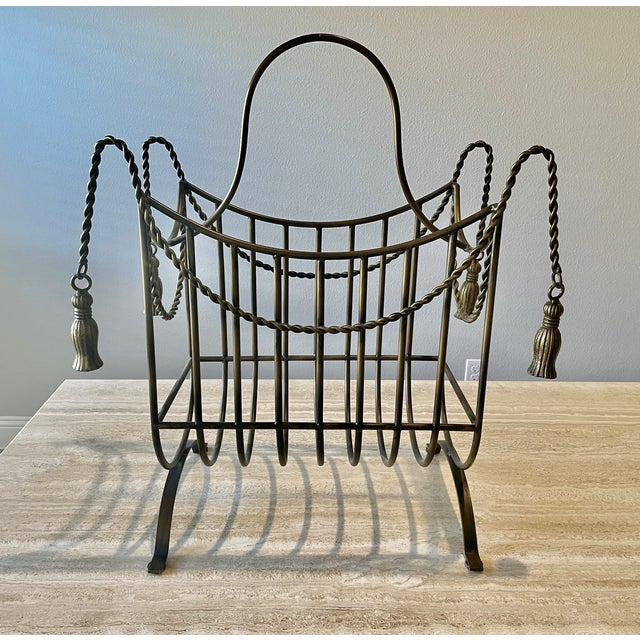 Hollywood Regency bronze tassle magazine/book rack. Larger than your average magazine rack, this could also be used for...