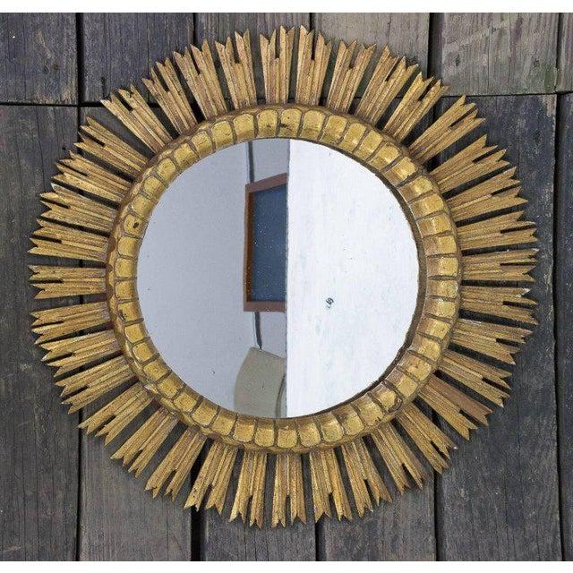 Beautiful giltwood carved mirror in a sunburst design, circa 1950s.