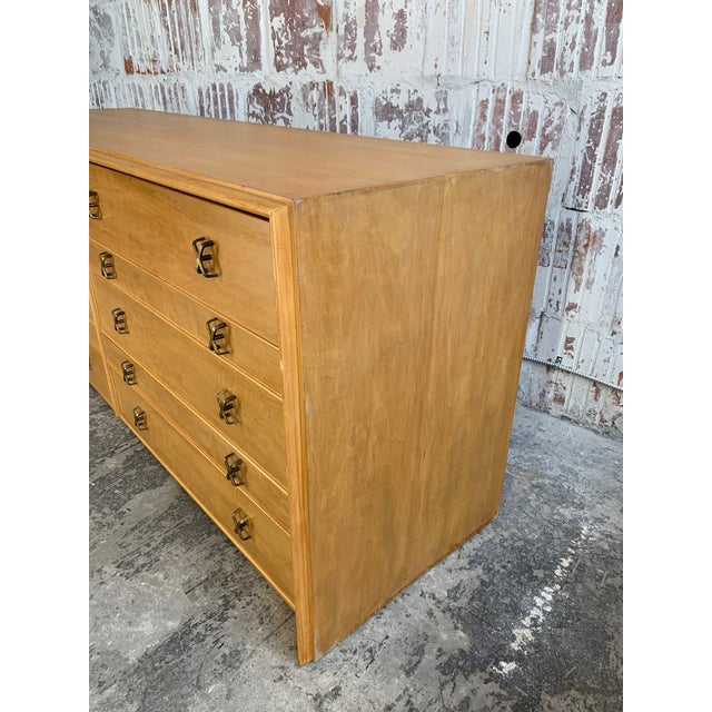 """""""Debonair"""" dresser designed by Paul Frankl and manufactured by Johnson Furniture Co. Circa 1950s. Features distinctive..."""