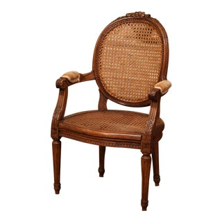 19th Century French Louis XVI Carved Walnut and Cane Child Armchair For Sale