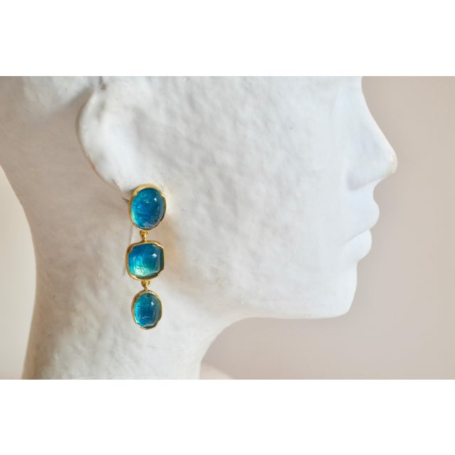 Hand tinted blue rock crystal triple drop clip earrings from Goossens Paris. Set in 24 karat gold plate.