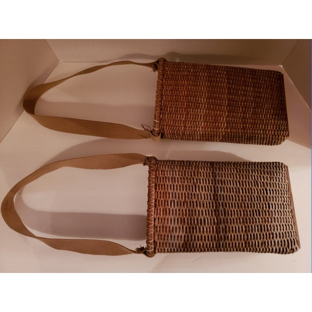 Vintage narrow baskets very similar to ammo baskets only smaller. Wood bottoms. Canvas strap. Nice condition, wicker is...