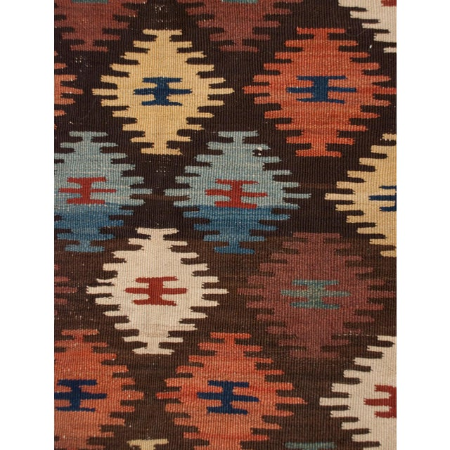 An early 20th century Persin Hersari Kilim runner with a beautiful multicolored diamond field, surrounded by a...