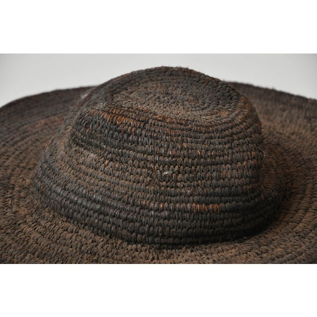 Early 20th century woven African hat from Cameroon This hat depicts life in Africa. The gorgeous object which would add...