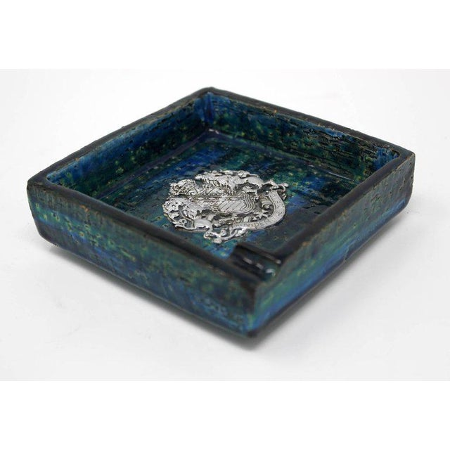 1960s ceramic blue ashtray designed by Aldo Londi of Bitossi for Rosenthal Netter. Made in Italy, and decorated with the...