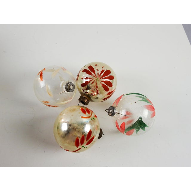 group of 4 silver and clear hand painted vintage christmas ornaments some fading color